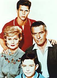 Jerry Mathers as the Beaver, Hugh Beaumont as Ward Cleaver, Barbara Billingsley as June Cleaver, Tony Dow as Wally Cleaver in Leave It To Beaver