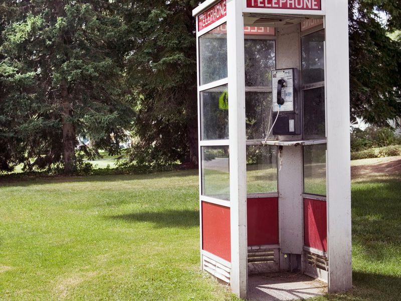 60s Fads - Phone booth in a middle of a field